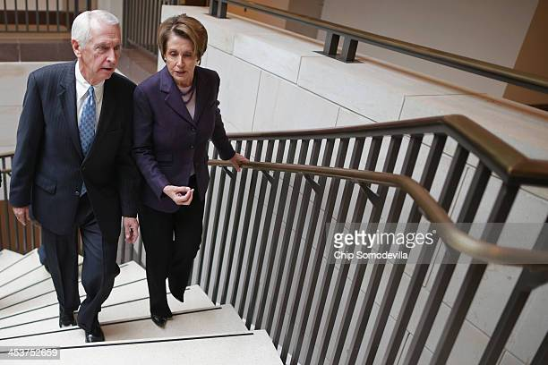 House Minority Leader Nancy Pelosi talks with Kentucky Governor Steve Beshear after a caucus meeting in the Capitol Visitors Center December 5 2013...