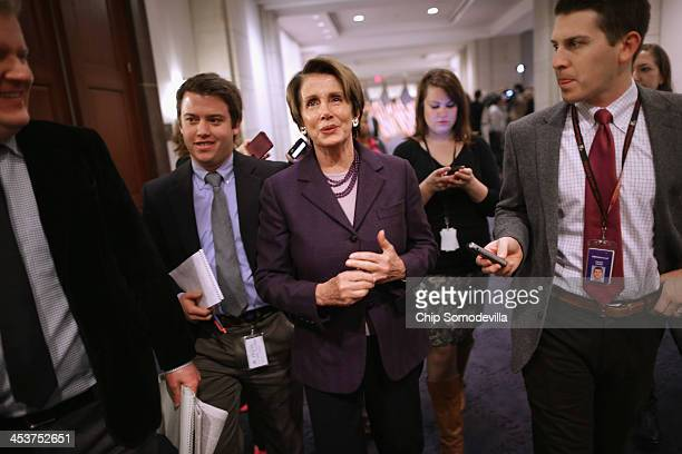 House Minority Leader Nancy Pelosi talks with reporters after a caucus meeting in the Capitol Visitors Center December 5, 2013 in Washington, DC....