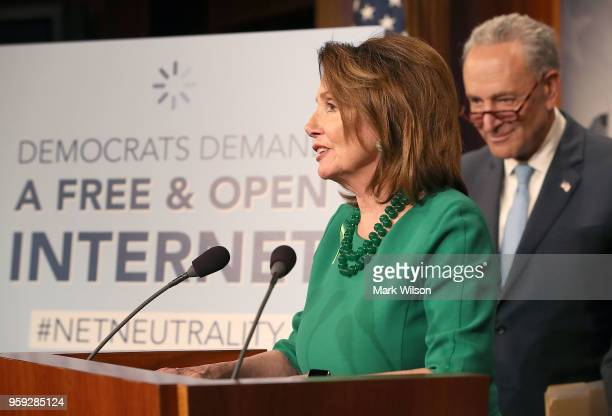House Minority Leader Nancy Pelosi with Senate Majority Leader Charles Schumer looking on speaks at a press conference at the Capitol Building on May...