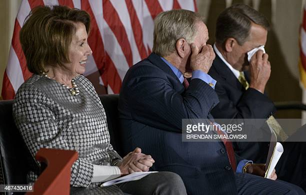 House Minority Leader Nancy PelosiDCA sits with golfer Jack Nicklaus and Speaker of the House John BoehnerROH while they wipe their eyes during a...