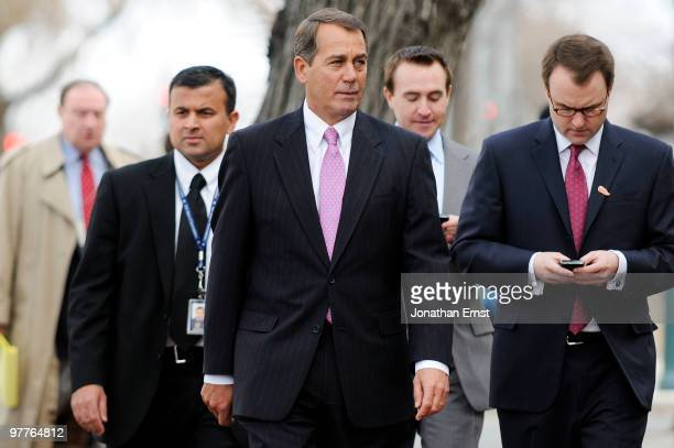 House Minority Leader Rep John Boehner arrives with staff members for a news conference to unveil a new GOP television ad against President Barack...