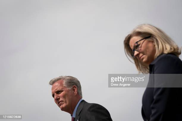 House Minority Leader Rep. Kevin McCarthy and Rep. Liz Cheney listen to questions during a news conference outside the U.S. Capitol, May 27, 2020 in...