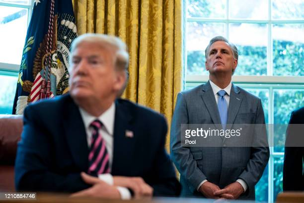 House Minority Leader Rep. Kevin McCarthy and U.S. President Donald Trump attend a signing ceremony for H.R. 266, the Paycheck Protection Program and...