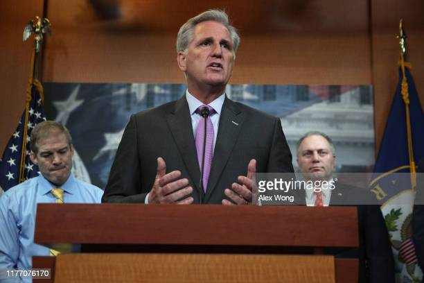 S House Minority Leader Rep Kevin McCarthy speaks as Rep Jim Jordan and House Minority Whip Rep Steve Scalise listen during a news conference at the...