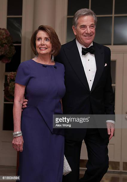 S House Minority Leader Rep Nancy Pelosi and her husband Paul Pelosi arrive at the White House for a state dinner October 18 2016 in Washington DC US...