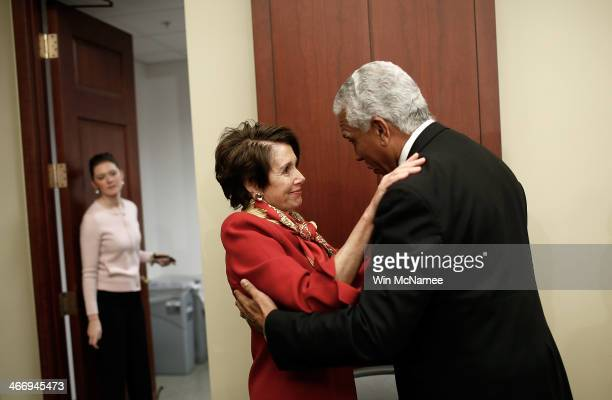 House Minority Leader Rep Nancy Pelosi embraces Hilary Shelton Director of the NAACP's Washington bureau following an event to announce the...
