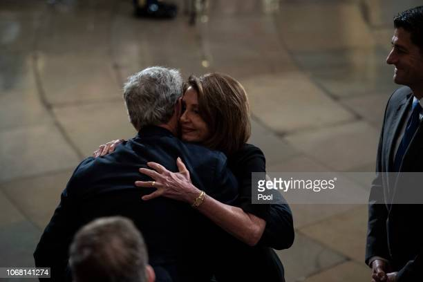 S House Minority Leader Rep Nancy Pelosi greets Former US President George W Bush after paying her respects to former US President George HW Bush at...
