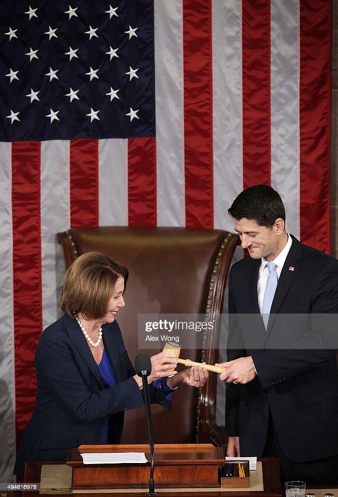 U.S. House Minority Leader Rep. Nancy Pelosi (D-CA) hands a gavel to incoming Speaker of the House Rep. Paul Ryan (R-WI) in the House Chamber of the Capitol October 29, 2015 on Capitol Hill in Washington, DC. Rep. Ryan has been elected to succeed Rep. John Boehner (R-OH) to be the new Speaker of the House.