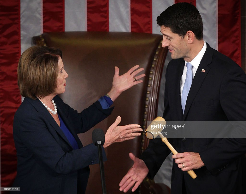 U.S. House Minority Leader Rep. Nancy Pelosi (D-CA) (L) hands a gavel to incoming Speaker of the House Rep. Paul Ryan (R-WI) (R) in the House Chamber of the Capitol October 29, 2015 on Capitol Hill in Washington, DC. Rep. Ryan has been elected to succeed Rep. John Boehner (R-OH) to be the new Speaker of the House.