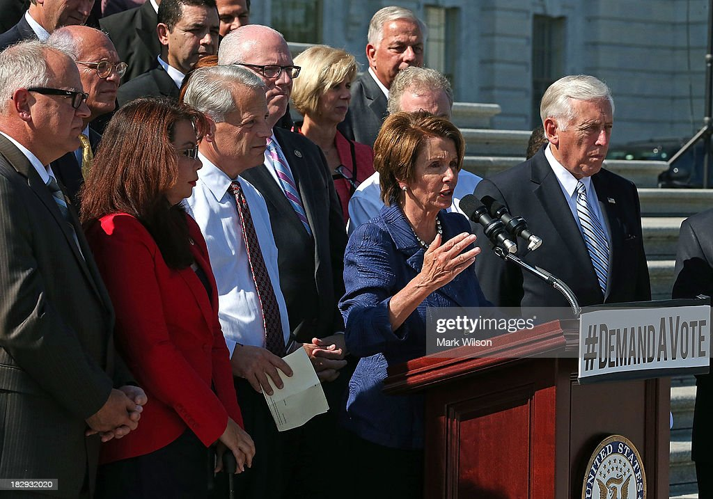 U.S. House Minority Leader Rep. Nancy Pelosi (D-CA) joined by House Democrats speaks on the steps of the House during a news conference on the federal government shutdown at the U.S. Capitol on October 2, 2013 in Washington, DC. Later today President Barack Obama will meet with congressional leaders at the White House to discuss an end to the government shutdown.