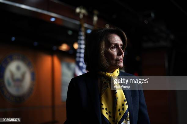 S House Minority Leader Rep Nancy Pelosi leaves after a weekly news conference March 1 2018 on Capitol Hill in Washington DC Pelosi held a weekly...