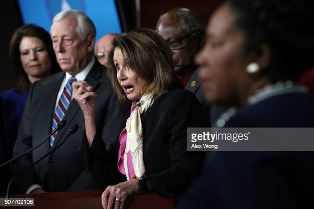 S House Minority Leader Rep Nancy Pelosi speaks as House Minority Whip Rep Steny Hoyer and other House Democrats listen during a news conference...