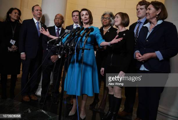 S House Minority Leader Rep Nancy Pelosi speaks to members of the media as Repelect Veronica Escobar Rep Adam Schiff Rep John Lewis Rep Eric Swalwell...