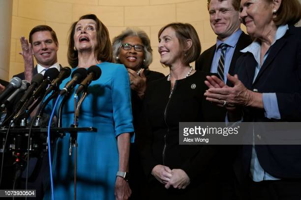 S House Minority Leader Rep Nancy Pelosi speaks to members of the media as Rep Eric Swalwell Rep Joyce Beatty Rep Kathy Castor Rep Joe Kennedy and...