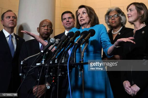 S House Minority Leader Rep Nancy Pelosi speaks to members of the media as Rep Adam Schiff Rep John Lewis Rep Eric Swalwell Rep Joyce Beatty and Rep...