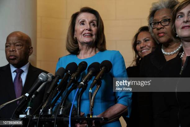 S House Minority Leader Rep Nancy Pelosi speaks to members of the media as Rep John Lewis Repelect Veronica Escobar Rep Joyce Beatty and Rep Kathy...