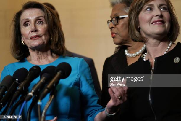 S House Minority Leader Rep Nancy Pelosi speaks to members of the media as Rep Joyce Beatty and Rep Kathy Castor listen at the lobby of Longworth...