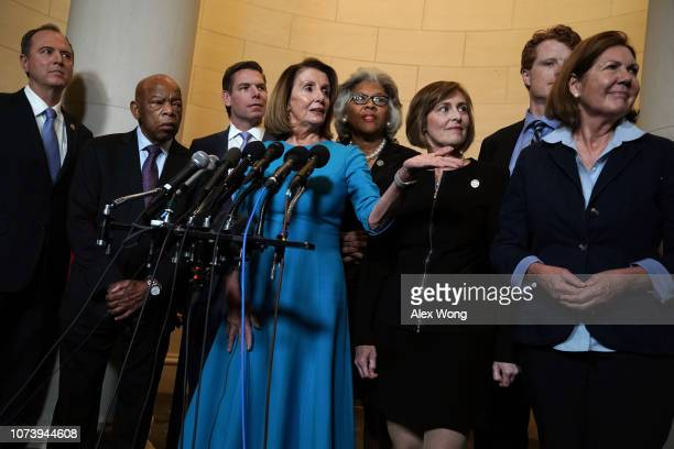 S House Minority Leader Rep Nancy Pelosi speaks to members of the media as Rep Adam Schiff Rep John Lewis Rep Eric Swalwell Rep Joyce Beatty Rep...