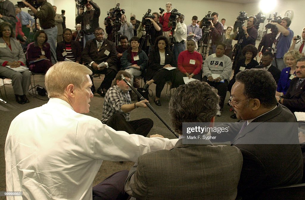 House Minority Leader Richard Gephardt (D-MO) shakes hands with Rev. Jesse Jackson before a host of media and ex-Enron employees who made a trip by bys from Texas to meet with Congressional leaders today.