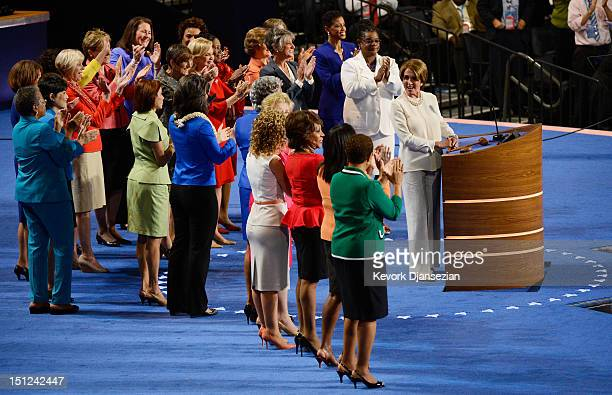 House Minority Leader Sen Nancy Pelosi speaks on stage with other female members of Congress during day one of the Democratic National Convention at...