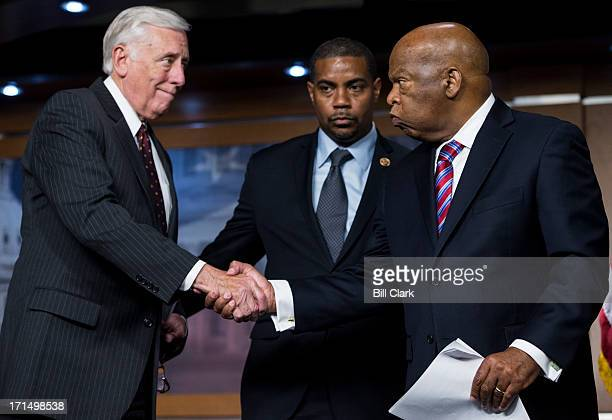 House Minority Leader Steny Hoyer DMd left shakes hands with Rep John Lewis DGa before speaking during the Congressional Black Caucus news conference...