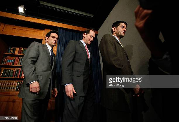 US House Minority Whip Rep Eric Cantor Rep Dave Camp and Rep Paul Ryan leave after a news conference on the health care legislation March 19 2010 on...