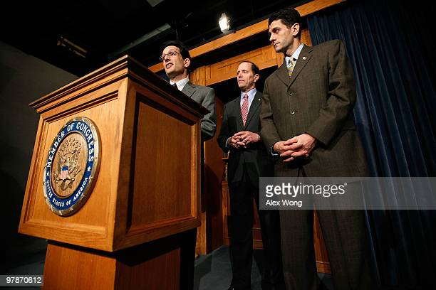 US House Minority Whip Rep Eric Cantor speaks as Rep Dave Camp and Rep Paul Ryan listen during a news conference on the health care legislation March...