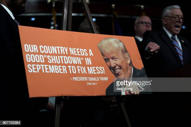 S House Minority Whip Rep Steny Hoyer speaks as he points to a poster of President Donald Trump during a news conference January 20 2018 on Capitol...