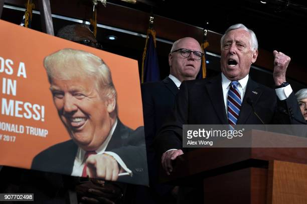 S House Minority Whip Rep Steny Hoyer speaks as Rep Joseph Crowley listens as a poster of President Donald Trump is seen during a news conference...