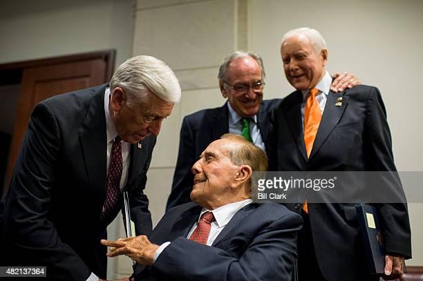 House Minority Whip Steny Hoyer DMd left speaks with former Senate Majority Leader Bob Dole RKan as former Sen Tom Harkin DIowa and Sen Orrin Hatch...