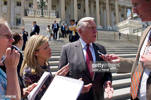 House Minority Whip Steny Hoyer DMd talks to reporters as he and other House Democrats exit the House chamber after a series of votes to board buses...