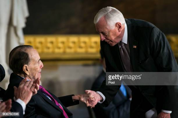 House Minority Whip Steny Hoyer greets former Senate Majority Leader Bob Dole during a congressional Gold Medal ceremony for Dole at the US Capitol...