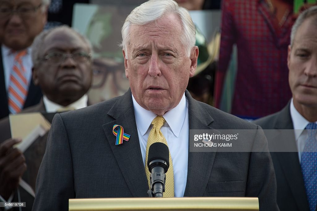 US House Minority Whip Steny Hoyer speaks as members and supporters of the US Congressional LGBT Equality Caucus hold pictures of victims of the Pulse nightclub attack, one month after a gunman killed 49 people at the club in Orlando, Florida, during a vigil on the East House steps of the US Capitol in Washington, DC, on July 12, 2016. / AFP / NICHOLAS