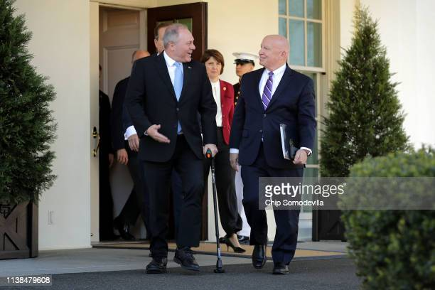 House Minority Whip Steve Scalise and House Ways and Means Committee ranking member Rep Kevin Brady lead fellow Republican members out of the White...
