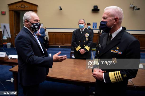 House Minority Whip Steve Scalise RLa left talks with Rear Adm John Polowczyk leader of the Supply Chain Stabilization Task Force and vice director...