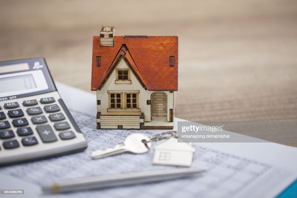 House model and calculator on table for finance ,selling home concept., bangking concept : ストックフォト
