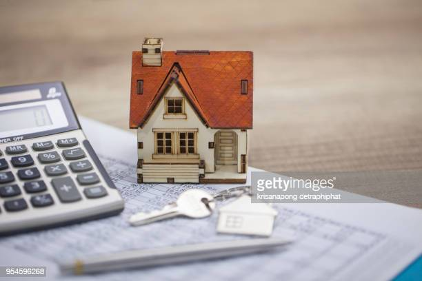 House model and calculator on table for finance ,selling home concept., bangking concept