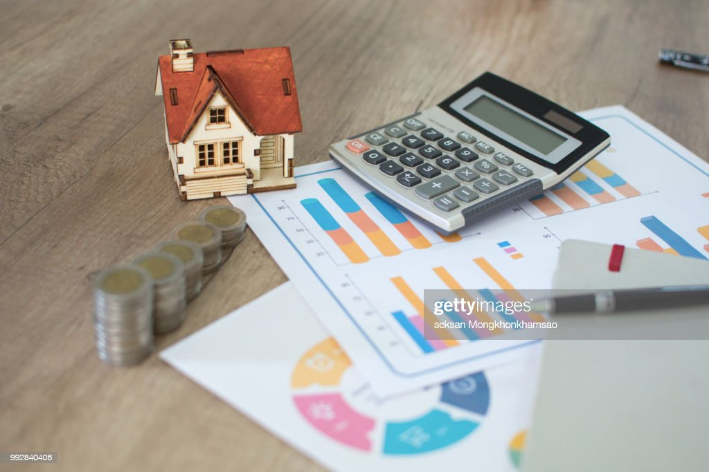 House Model And Coin On Bank Account Calculator Table For Finance Banking Concept