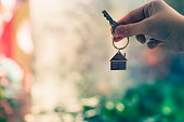 House model and key in home insurance broker agent  hand or in salesman person. Real estate agent offer house, property insurance and security, affordable housing concepts