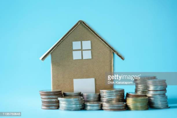 house model around with stacking coins