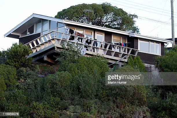 House near Shag Rock, Sumner stands damaged after two earthquakes, a magnitude 6.0 and 5.5, struck on June 13, 2011 in Christchurch, New Zealand. The...