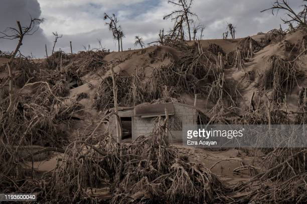 A house near Taal Volcano's crater is seen buried in volcanic ash from the volcano's eruption on January 14 2020 in Taal Volcano Island Batangas...