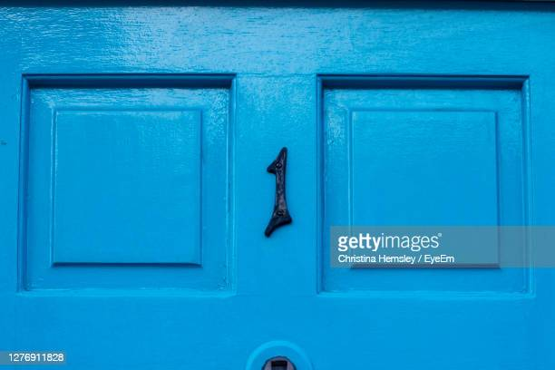 house number 1 on a blue wooden front door in london - single object stock pictures, royalty-free photos & images