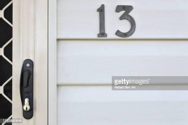 house number 13 on a wooden wall - rafael ben ari fotografías e imágenes de stock