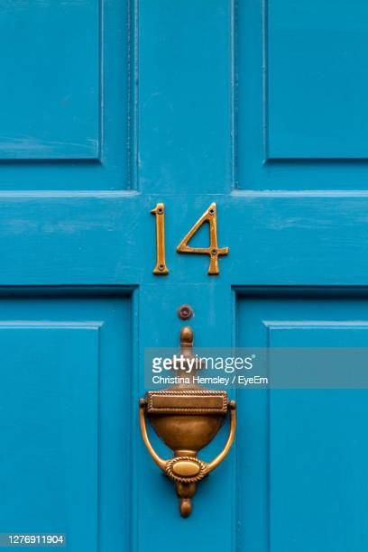 house number 14 on a blue wooden front door in london - number stock pictures, royalty-free photos & images