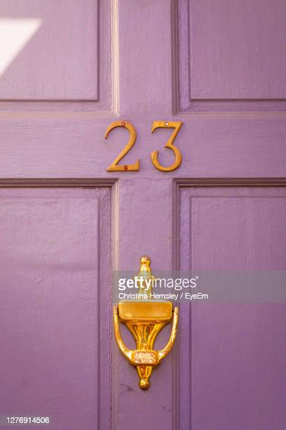 house number 23 on a wooden front door in london - door stock pictures, royalty-free photos & images