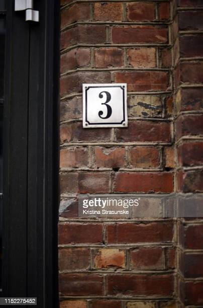 house number 3 - kristina strasunske stock photos and pictures