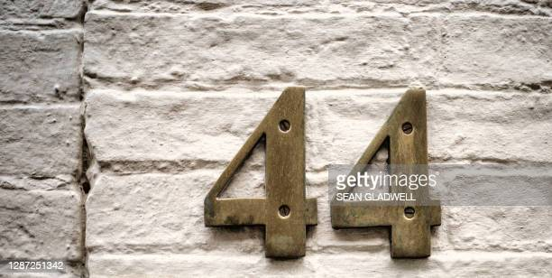 house number 44 - embellishment stock pictures, royalty-free photos & images