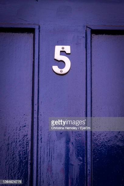 house number 5 on a blue wooden front door - number stock pictures, royalty-free photos & images