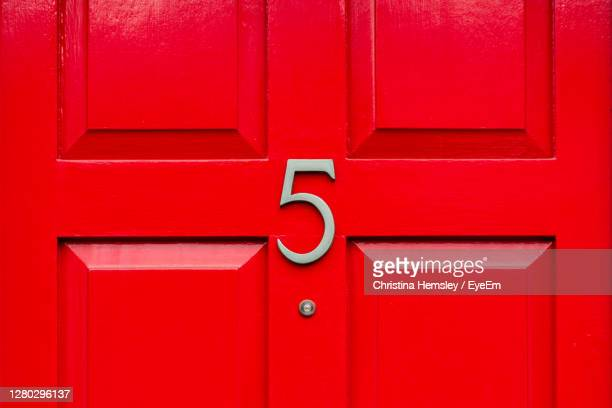 house number 5 on a red wooden front door in london - door stock pictures, royalty-free photos & images
